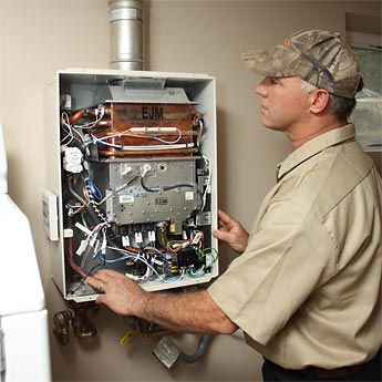 Lewis Plumbing Services installing a tankless water heater